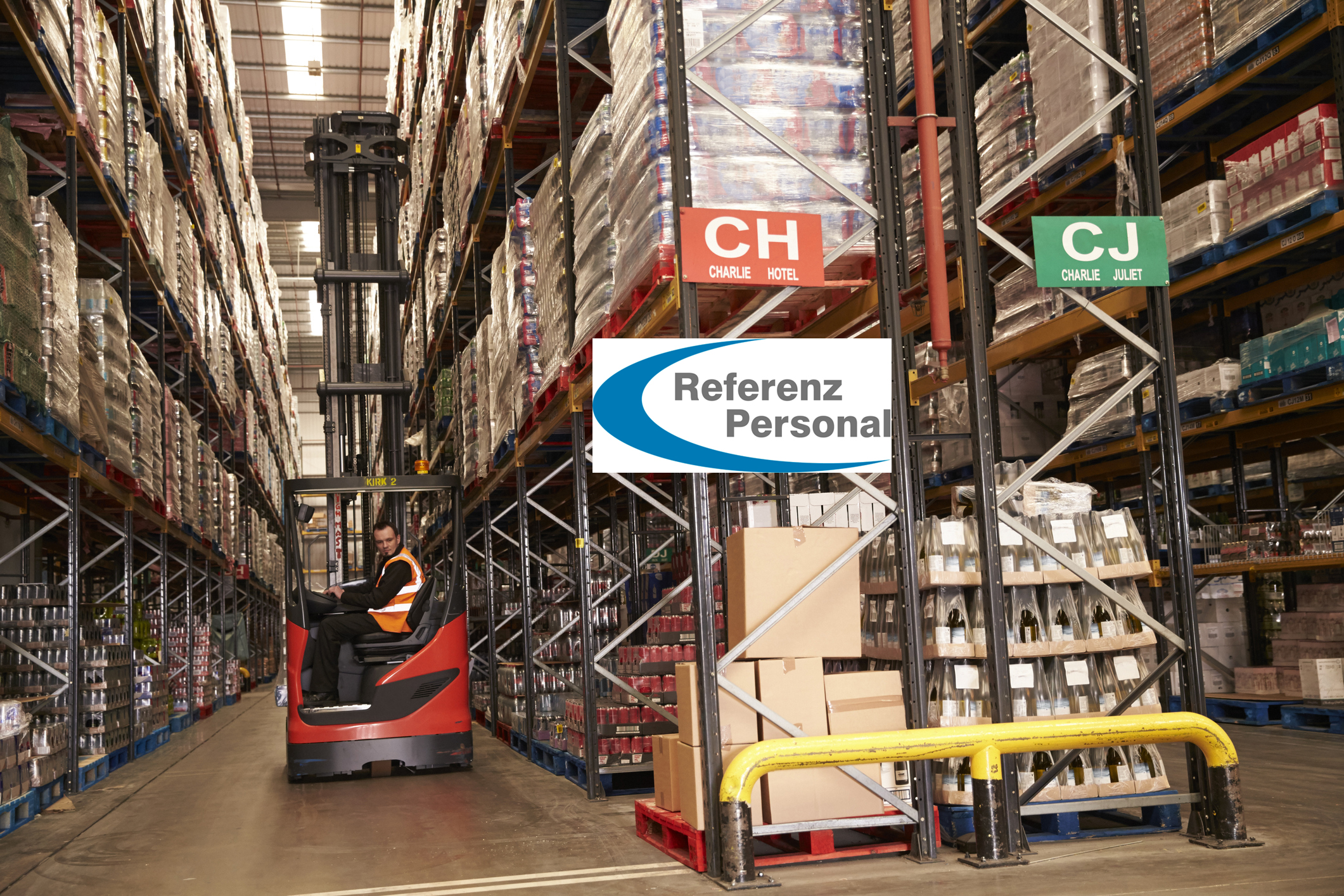 Man using aisle truck in a distribution warehouse, side view