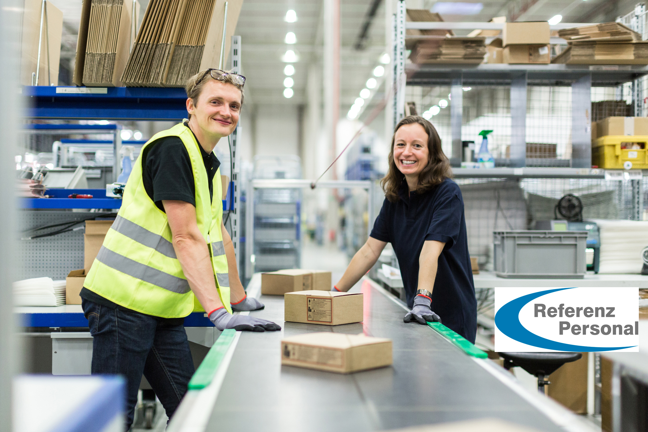 Young man and woman working in warehouse